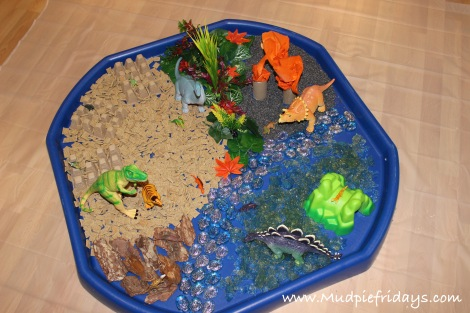 Dinosaur Small World Sensory Play - jelly, shreddies, glass stones, bark and rice. Ideal for toddlers and pre schoolers